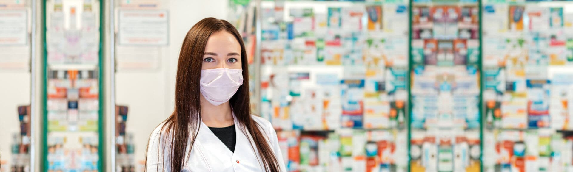 A female pharmacist in a medical mask