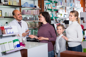 customers consulting to the pharmacist for the medicine